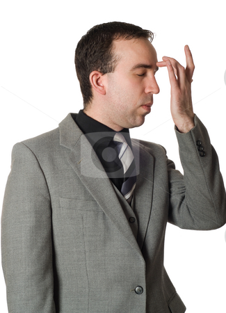 Emotional Freedom Technique stock photo, Closeup view of a man wearing a suit tapping his brow as part of the steps in performing EFT by Richard Nelson