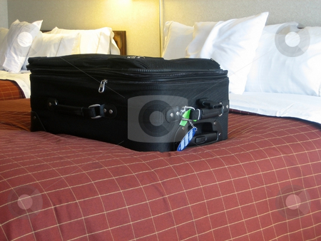 Luggage in hotel room stock photo, Luggage in the beds of a hotel room by Albert Lozano