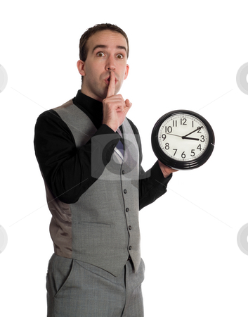 Man Changing Deadline stock photo, A businessman holding a finger to his lips to be quiet while he is about to change the time on a clock, isolated against a white background by Richard Nelson