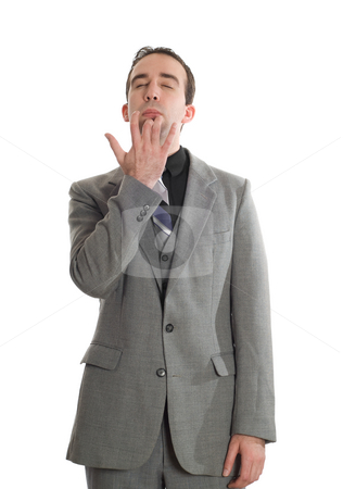Emotional Freedom Technique stock photo, Front view of a businessman tapping his chin as a step in performing the Emotional Freedom Technique, isolated against a white background by Richard Nelson