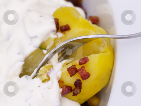 Potatoes stock photo, Herbs-flavoured curd and bacon on potatoes by Torsten Lorenz