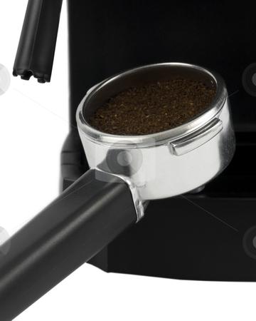 Close up of espresso grounds stock photo, Close up of espresso grounds in filter holder by John Teeter