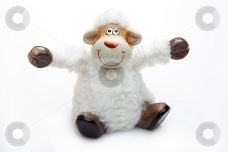 Smiling sheep toy over white background stock photo, Smiling sheep toy over white background.Unsharpened image. by Ivelin Radkov