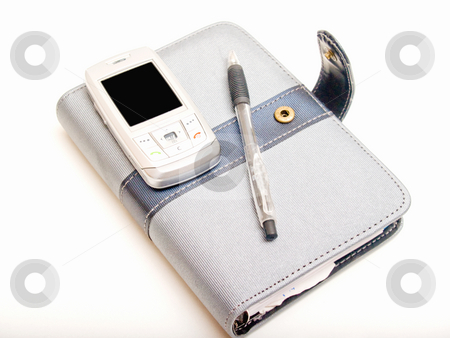 Office objects - Pen diary and a cell phone stock photo, Office objects - Pen diary  and a cell phone by Phillip Dyhr Hobbs