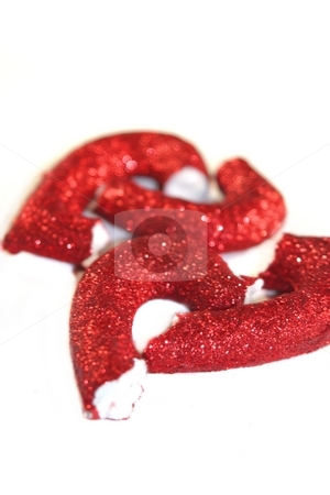 Broken Heart stock photo, Pieces of a red broken hard on white background by Henrik Lehnerer