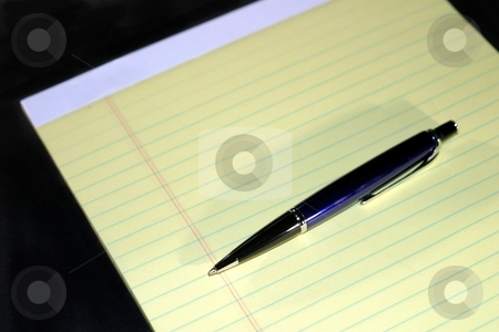 Notepad Pen Help stock photo, Yellow notepad with the text HELP and a blue pen. by Henrik Lehnerer