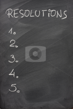List of resolutions on a blackboard stock photo, Blank list of five resolutions handwritten with white chalk on a blackboard with strong eraser patterns by Marek Uliasz