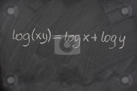 Logarithm formula on a school blackboard stock photo, Logarithm formula (reduction of multiplication to addtion) handwritten with white chalk on a school blackboard with eraser smudges and pattern by Marek Uliasz
