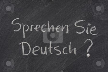Do you speak German question on a blackboard stock photo, Sprechen Sie Deutsch? Do you speak German question handwritten with white chalk on a blackboard with eraser smudges by Marek Uliasz