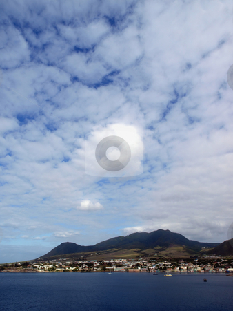 Cloudy skies over St. Kitts stock photo, View of St. Kitts under cloudy blue sky by Jill Reid