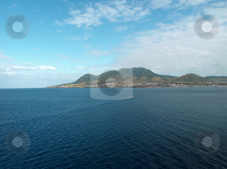 St. Kitts panorama  stock photo, View of St. Kitts under cloudy blue sky by Jill Reid