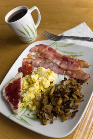 Big Delicious Breakfast stock photo, A complete breakfast with scrambled eggs bacon homefry potatoes toast and a coffee. by Todd Arena