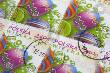 Colored easter eggs on old post stamps  stock photo, Easter (Wielkanoc in Polish) - colorful eggs and floral folk decorations on old post stamps from Poland canceled in Warsaw by Marek Uliasz