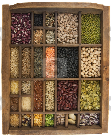 Beans, grains, seeds in vintage typesetter box stock photo, Vintage, wooden typesetter case (drawer) with variety of beans, lentils, peas, grains and seeds isolated on white, white angle view by Marek Uliasz