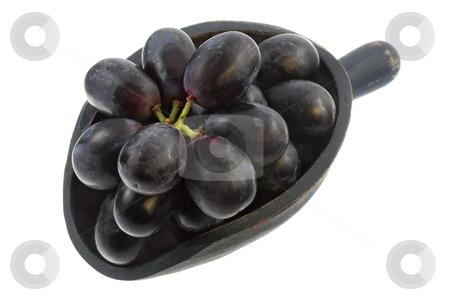 Scoop of black grapes stock photo, Bunch of black grapes on a rustic wooden scoop isolated on white by Marek Uliasz