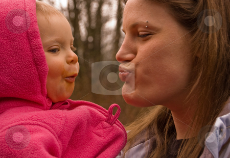 Family Fun Moment stock photo, A fun, candid moment with young adult aunt with her baby girl niece making silly faces at each other while enjoying this family together time. by Valerie Garner
