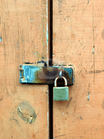 Rusty padlock and hasp on weathered painted door stock photo, Rusty padlock and hasp on weathered painted wooden door by Jill Reid