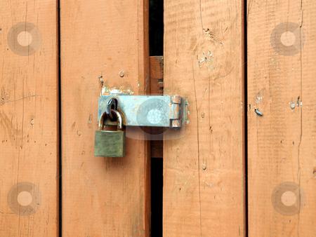 Padlock hasp on weathered painted door stock photo, Rusty padlock and hasp on weathered painted wooden door by Jill Reid