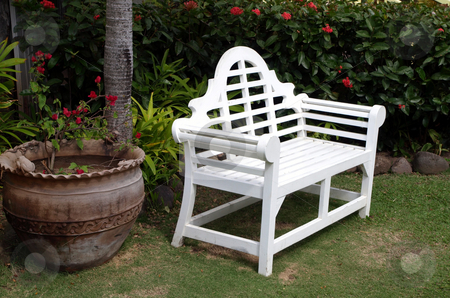 White bench in peaceful garden stock photo, An inviting white painted wooden bench in an outdoor garden by Jill Reid