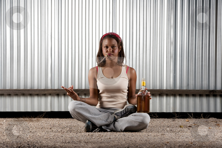 Cigar smoking and drinking woman meditating stock photo, Woman meditating with cigar and tequila bottle by Scott Griessel