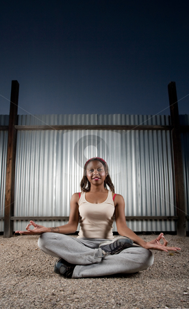 African-American woman meditating stock photo, African-American woman meditating in front of corrugated metal by Scott Griessel