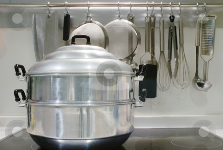 Stovetop steamer stock photo, A large stove-top steamer on a modern glass hob by Martin Darley