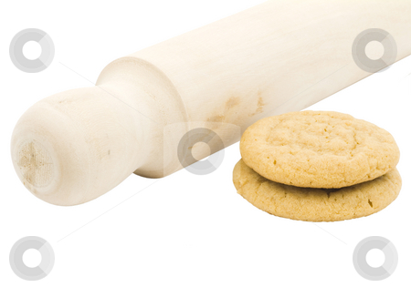 Peanut butter cookies stock photo, Peanut butter cookies with a rolling pin by John Teeter