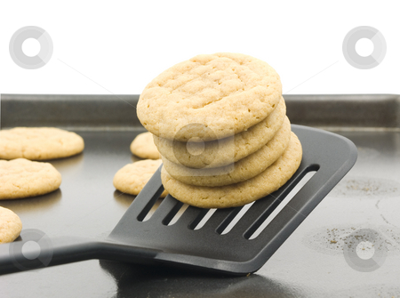 Peanut butter cookies stock photo, Peanut butter cooking stacked on spatula by John Teeter