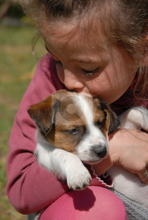 Child and puppy stock photo, Little girl and her puppy purebred jack russel terrier by Bonzami Emmanuelle