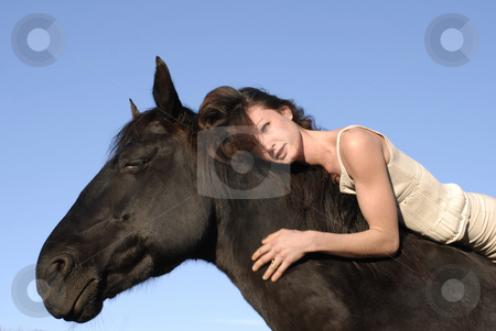 Woman and horse stock photo, Young woman and her best friend black stallion by Bonzami Emmanuelle