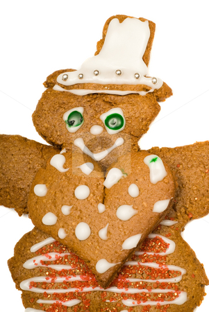 Heart Man stock photo, Closeup view of a gingerbread man wearing a large heart on his chest, isolated against a white background by Richard Nelson