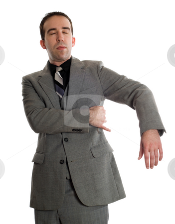 Emotional Freedom Technique stock photo, Front view of a businessman tapping under his arm as a step in performing the Emotional Freedom Technique, isolated against a white background by Richard Nelson