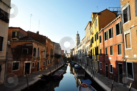 Venice canal with boats and sunlight stock photo, Venice canal with boats and sunlight by Jaime Pharr