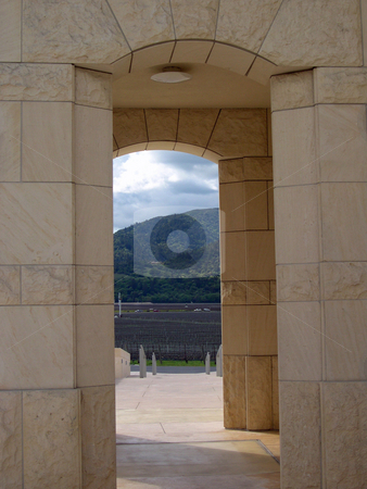 View of vineyard through archway    stock photo, View of Napa vineyard in through archway by Jaime Pharr