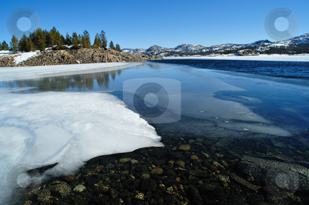 Winter Lake stock photo, Snow covered shoreline on a sierra mountain lake, Loon lake, El Dorado Country, California by Lynn Bendickson