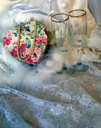 Silk and lace lingerie with floral heart, pearls and wine glasses stock photo,  by Jill Reid