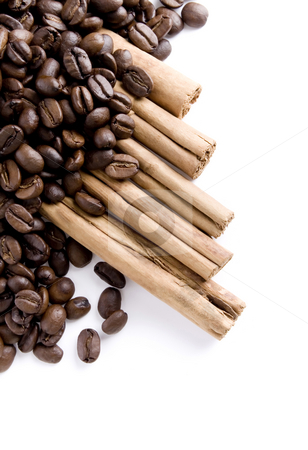 Coffee beans and Cinnamon stock photo, Close up of Coffee beans and cinnamon over white background by iodrakon
