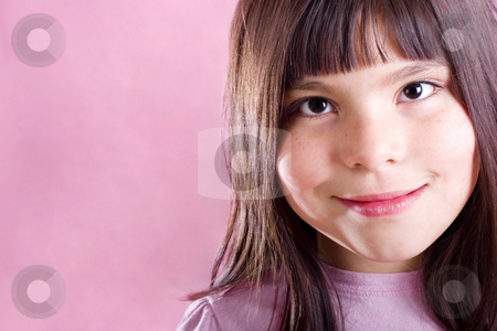 Cute girl Smiling stock photo, Cute girl smiling over pink background with copy space by iodrakon