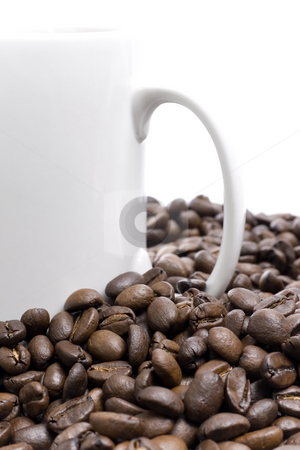 Coffee beans and cup stock photo, Coffee beans and cup over white background by iodrakon