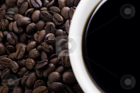 Coffe beans and cup stock photo, Closeup of coffe beans and cup, cup out of focus by iodrakon