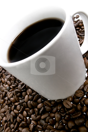 Coffee beans and cup stock photo, Close up of coffee beans and cup over white background by iodrakon