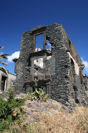 Old ruin stock photo, Ruined building on the coast of Madeira, near Canico. Polarised blue sky by Helen Shorey