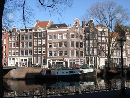 Amsterdam canal stock photo, Buildings, canal and canalboat in Amsterdam by Jaime Pharr