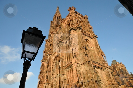 Strasbourg cathedral stock photo, Strasbourg cathedral with lamp post and sky by Jaime Pharr