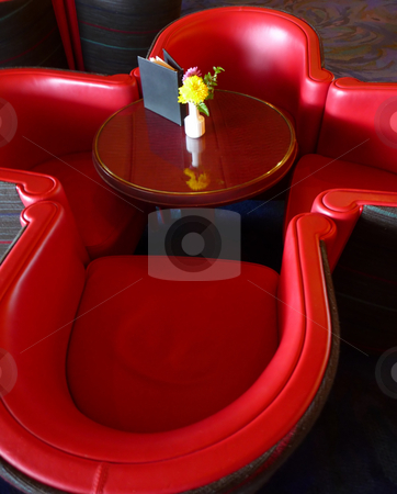 Contemporary red leather chair stock photo, Contemporary red leatehr chairs around small round table by Jill Reid