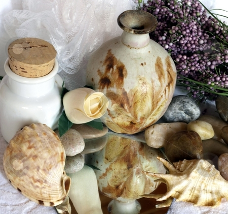 Seashell and jars reflect in spa setting stock photo, Collection and reflection of spa items, seashells and jars by Jill Reid