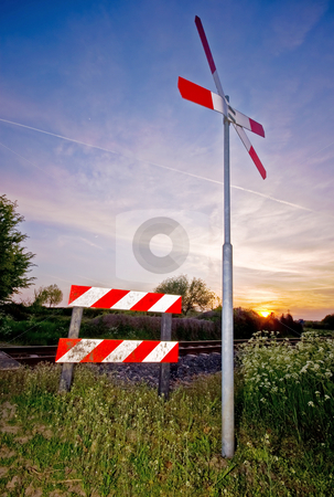 Railroad sign with sunset stock photo, Crossing railroad sign with a nice colorful sunset by Karin Claus