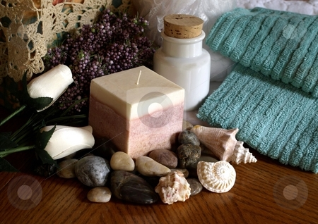 Spa essentials, candles and pebbles stock photo, A luxurious setting of cancles, roses, pebbles and towels by Jill Reid
