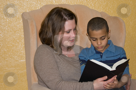 Young Mother and Son Reading Together stock photo, Young mother and her multi racial son are sharing a family moment by reading together. by Valerie Garner