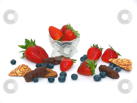 Fruit and chocolate  stock photo, Strawberries, blueberries and chocolate with a crystal bowl on white background. by Horst Petzold